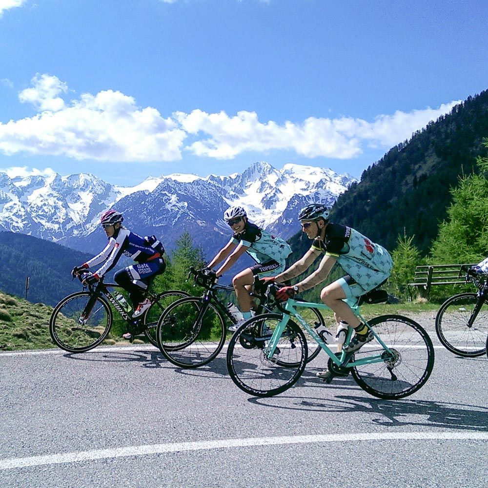 Riding the Giro with Topbike Tours - A Smiling Daniela (centre) with David Olle (front)